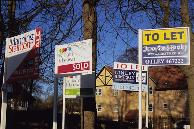 APF20F numerous for sale and to let signs outside homes in leeds yorkshire uk