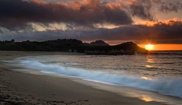 Sunset at Monastery Beach, Carmel, California, USA.