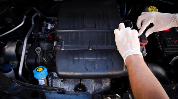 mechanic checks auto electronic ...