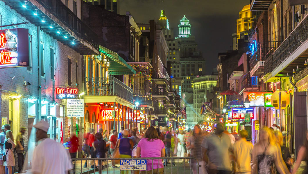 NEW ORLEANS, USA - JULY 14, 2013: Neon lights in the French Quarter in New Orleans, USA. Tourism provides a much needed source o