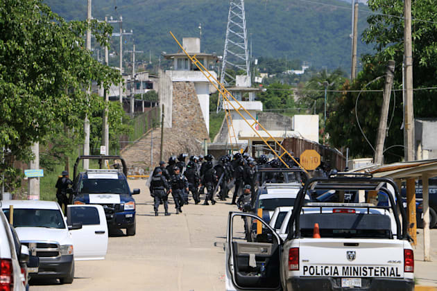 Riot police stormed the Las Cruces prison after the fighting broke out in the early hours of Thursday