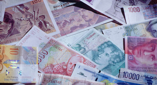 Close-up image of obsolete monetary bank notes of various countries.