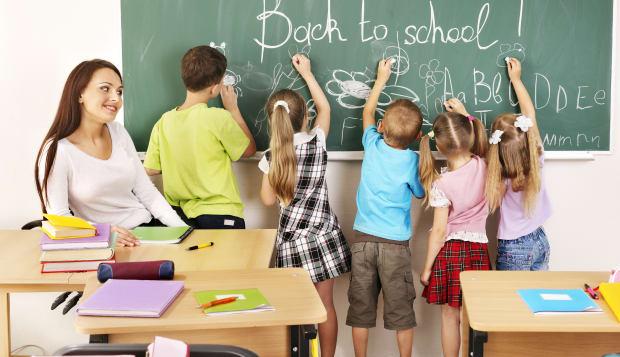 children writing on blackboard...