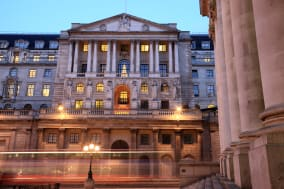 Bank of England, Threadneedle St, London.  Long exposure showing London bus passing in foreground