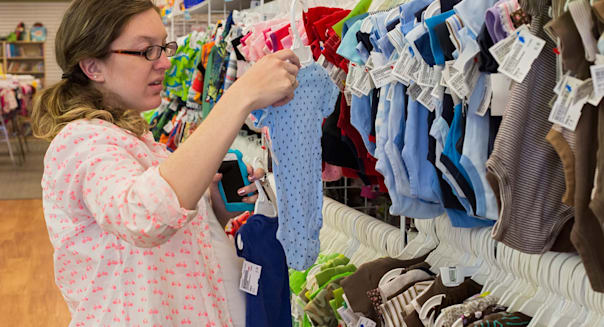 Denver, Colorado - Mariel West, 26, who is pregnant with her first child, shops for baby clothes at a resale shop.