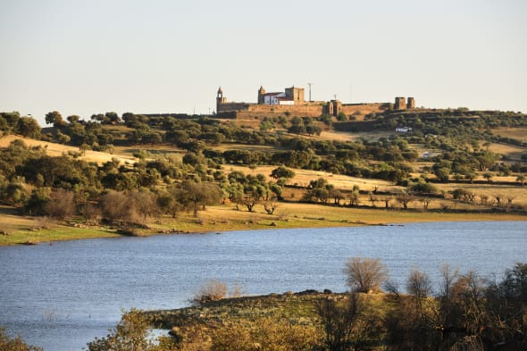 The medieval castle of Mourao, overlooking the Alqueva dam. Alentejo, Portugal