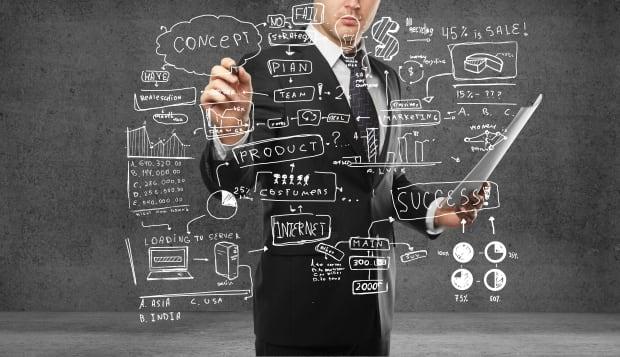 businessman drawing plan...