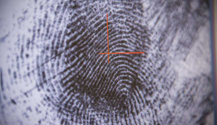 Fingerprint on screen in forensic lab