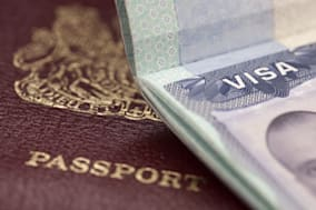 UK passport and US visa background with shallow depth of field. inspector note please use model release of file 8290405 if neede