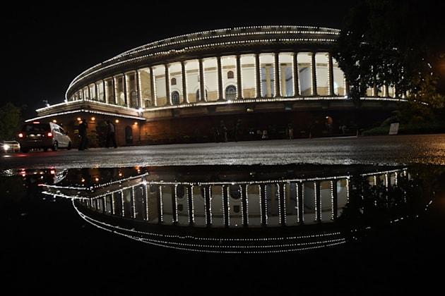 View of the Indian Parliament illuminated prior to a special session for the implementation of the new...