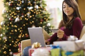 Teenage girl using laptop computer at Christmas