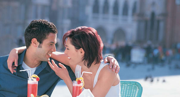 Couple seated at Grand Cafe, St Mark's Square, Venice, ItalyCity, Vacations, Travel Destinations, Horizontal, Waist Up, Outdoo