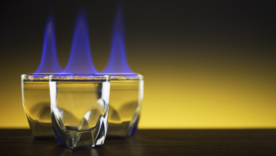 Shot glasses on fire - Flame Burning Alcohol Party