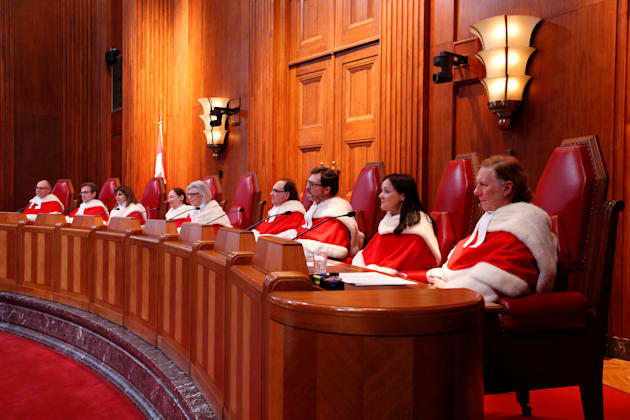Canada's Supreme Court justices take part in an official welcome ceremony at the Supreme Court of Canada...