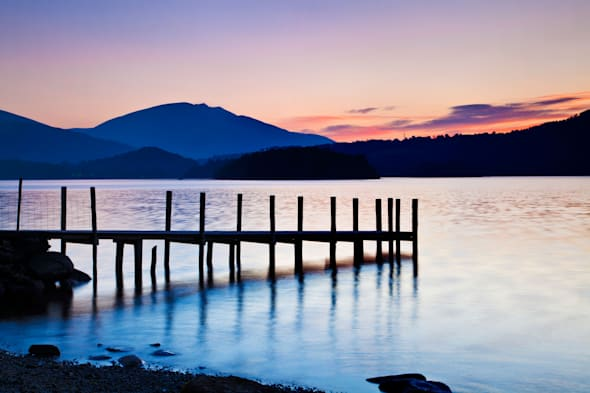 Sunrise over Derwent Water from Brandelhow, Lake District, Cumbria, England, UK