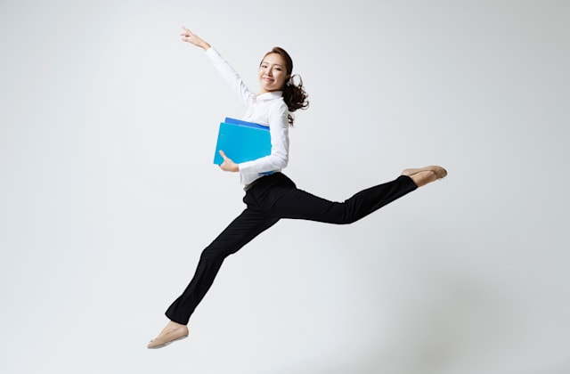 a woman making dance poses with a file