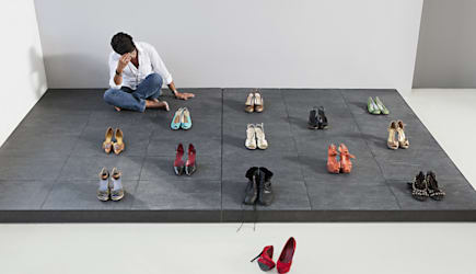 Woman arranging pairs of shoes