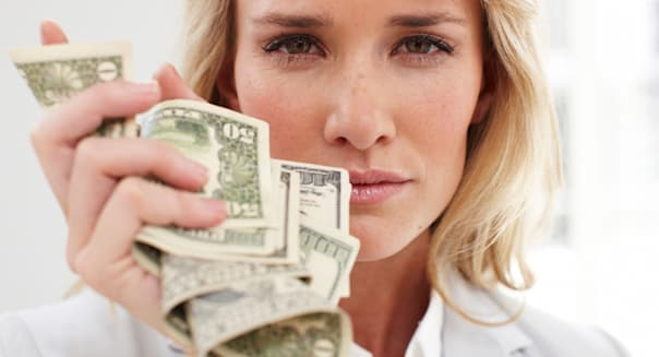 BHM04B Young woman with dollars  girl; woman; money; dollars; beautiful; business; beauty; blond; face; close; up; portrait; hap