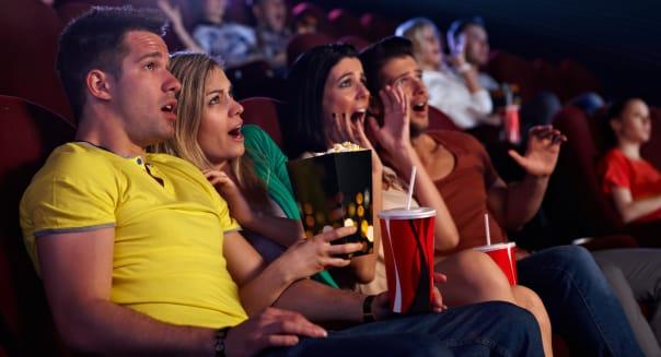 audience sitting in multiplex...