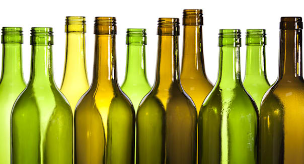 Empty glass wine bottles, washed and ready for recycling.