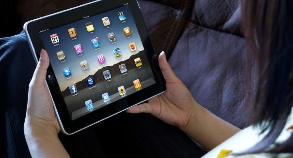 A woman relaxing showing iPad apps screen