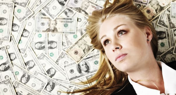 Beautiful blonde woman on US dollar background