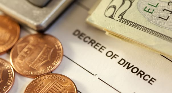 studio shot of divorce decree form with money