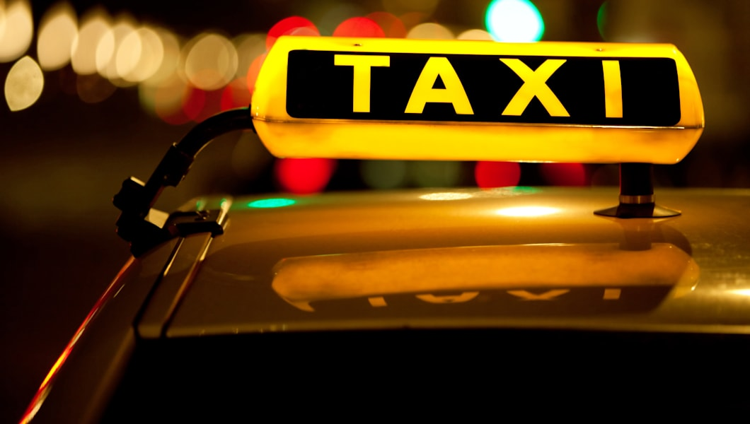 taxi cab sign on top of the...