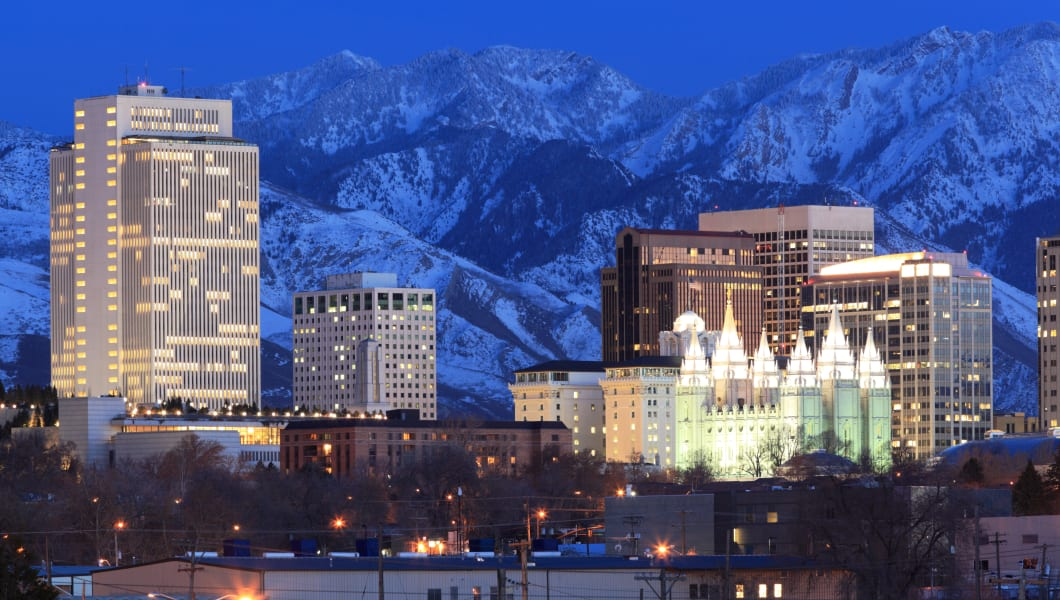 Salt Lake City, Utah skylineCaption:  Downtown Salt Lake City, Utah at night, with the Wasatch mountains in the backgroundCrea