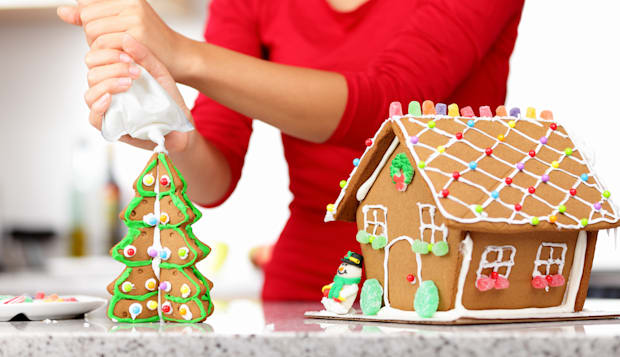 gingerbread house. woman in...