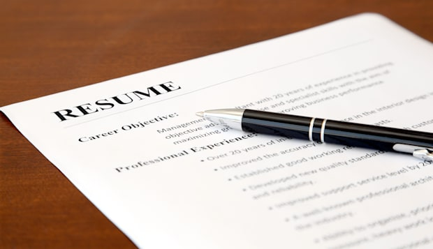 closeup of resume with pen on...