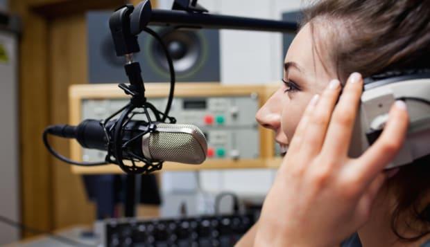 smiling radio host speaking...