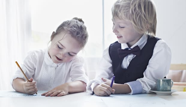 Children drawing together at table