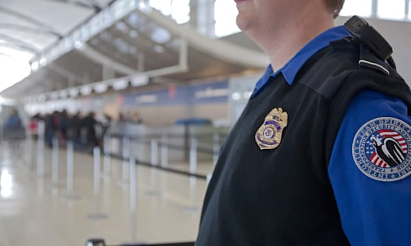 Romulus, Michigan - A security officer watches passengers arriving at Detroit Metropolitan Airport.