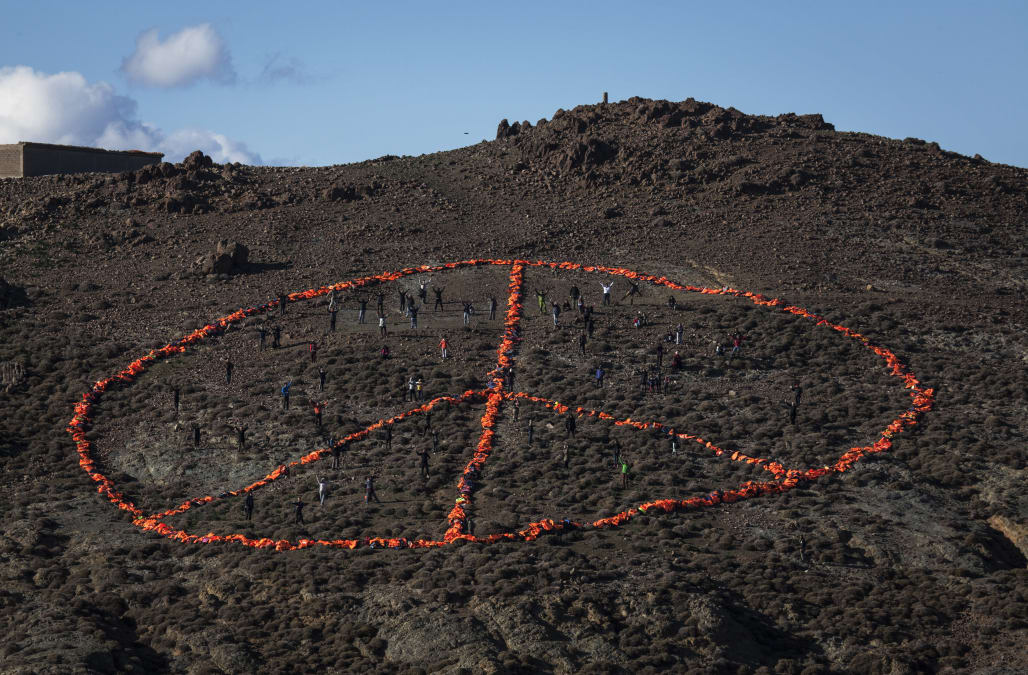 Giant Peace Symbol Honors Refugees In Lesbos
