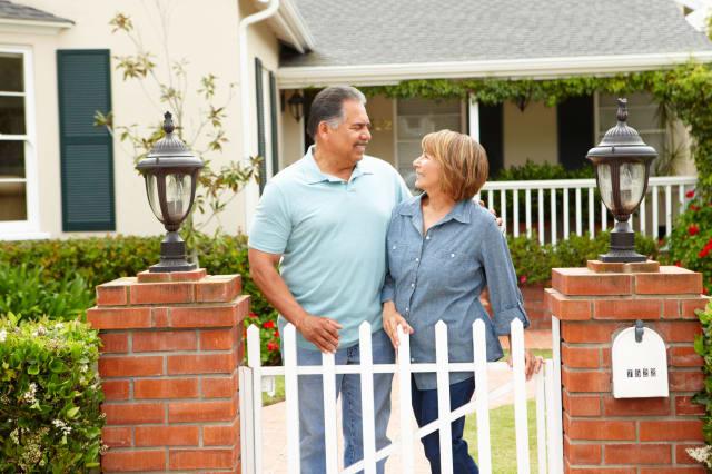 C93KYA Senior Hispanic couple outside home retirement Senior; Hispanic; couple; outside; home; senior; couple; hispanic; outside