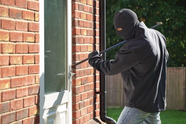 burglar breaking into a house...