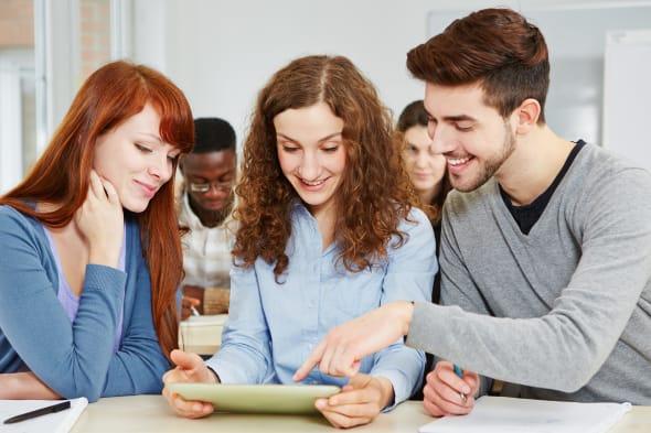 three happy students learning...