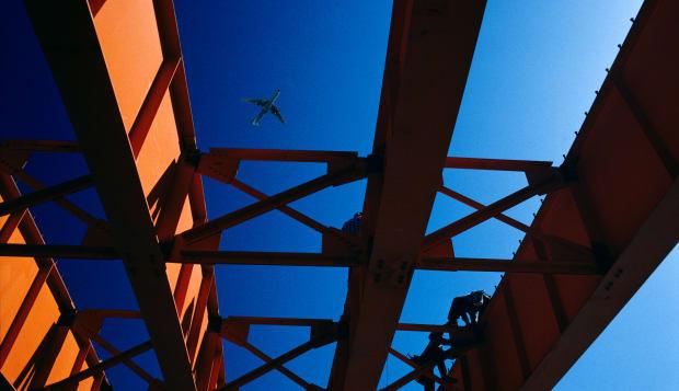 Steel workers assembling steel beams on new freeway bridge Tucson Arizona