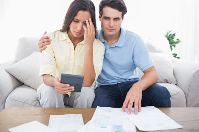 anxious couple doing their...