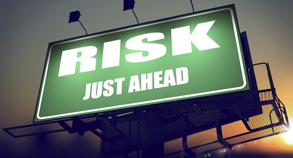 Risk Just Ahead on Green Billboard.