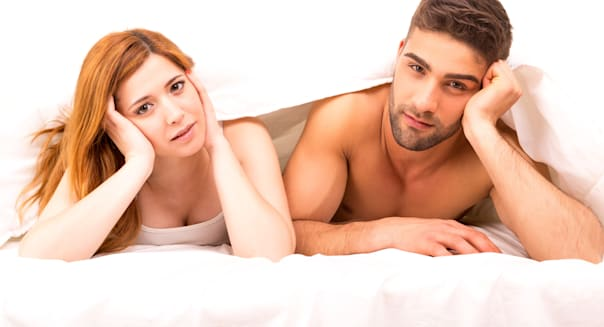 young depressed couple in bed   ...