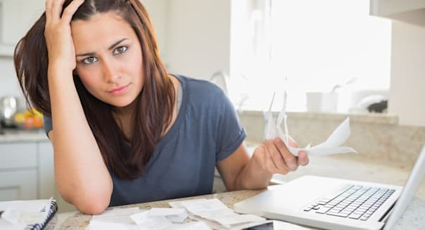 CYBBKF Young woman looking worried over finances problem money bills home Young; woman; looking; worried; over; finances; 20s; Y