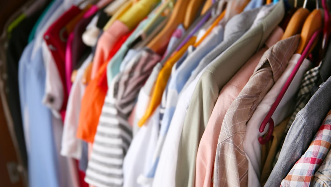 clothes neatly hanging in the...