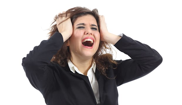 Bankrupt businesswoman crying desolated isolated on a white background