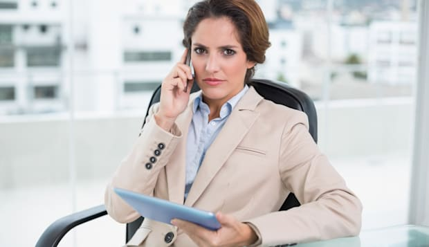 frowning businesswoman using...