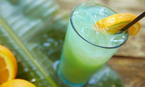 Blue hawaiian cocktail on bar counter