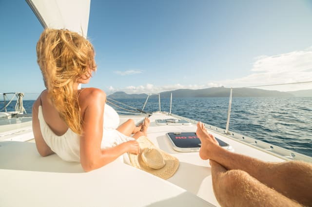 Young couple relaxing on sailing boat