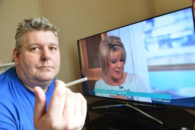 Thomas Defty with the faulty television.