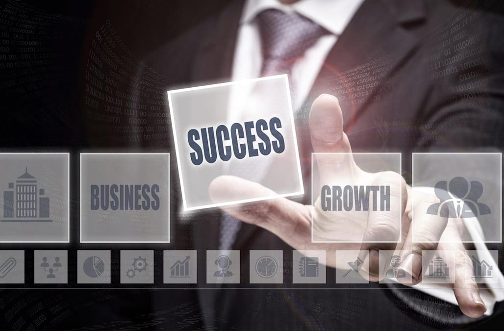 Businessman pressing an Success concept button.